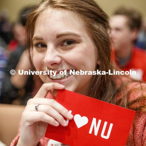 "Sheridan Macy, a senior in political science and history, shows off her ""I love NU"" postcard at the NU Advocacy Day in the Capitol. March 10, 2020. Photo by Craig Chandler / University Communication."