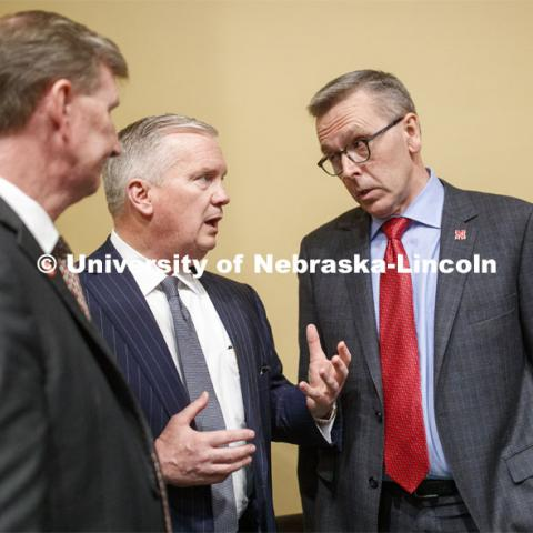 Regent Timothy Clare, center, talks with NU President Ted Carter at left and UNL Chancellor Ronnie Green at right. NU Advocacy Day at the Capitol. March 10, 2020. Photo by Craig Chandler / University Communication.