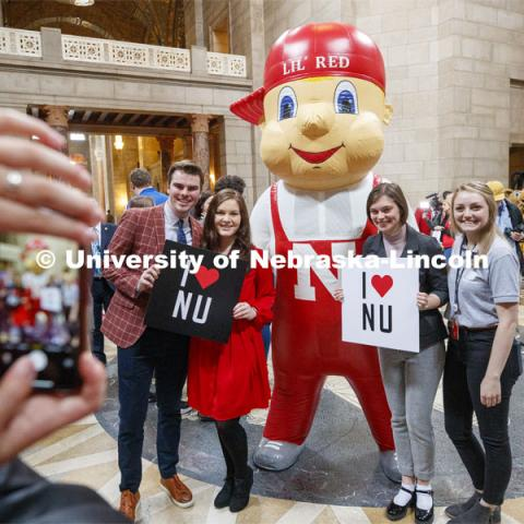 Lil' Red poses with UNL students in the rotunda. NU Advocacy Day at the Capitol. March 10, 2020. Photo by Craig Chandler / University Communication.
