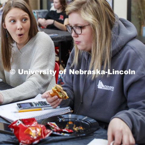 Emily Reitz, sophomore in Agricultural Education from Eaton, Colorado, reacts as she and Maggie Vyhnalek - a sophomore in Agricultural Education from Friend, NE, work on a quiz while eating. Lunch In The Lobby in the Animal Science building lobby is part of CASNR week. March 11, 2020. Photo by Craig Chandler / University Communication.