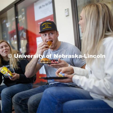 Sloane Tiarks, Chad Bode and Rachel Stewart enjoy lunch Wednesday. Lunch In The Lobby in the Animal Science building lobby is part of CASNR week. March 11, 2020. Photo by Craig Chandler / University Communication.