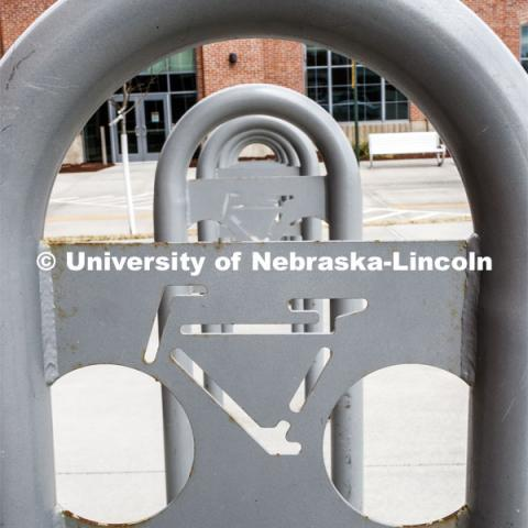 An empty bicycle rack sits outside the Food Innovation Center at Nebraska Innovation Campus. March 25, 2020. Photo by Craig Chandler / University Communication.
