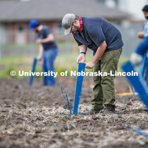 James Schnable and his group hand plants corn and sorghum seeds at the East Campus ag fields. May 20, 2020. Photo by Craig Chandler / University Communication.