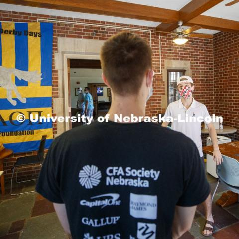Noah Wilger, sophomore from Lincoln, gives a tour to incoming freshman Joe Vacek. Sigma Chi recruitment day. Sigma Chi members are wearing masks as a result of the COVID-19 pandemic. May 29, 2020. Photo by Craig Chandler / University Communication.