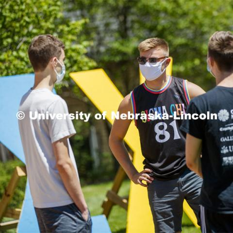 Sigma Chi recruitment day. Sigma Chi members are wearing masks as a result of the COVID-19 pandemic. May 29, 2020. Photo by Craig Chandler / University Communication.