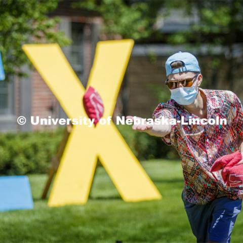 Sigma Chi members play Corn Hole on recruitment day. Sigma Chi members are wearing masks as a result of the COVID-19 pandemic. May 29, 2020. Photo by Craig Chandler / University Communication.