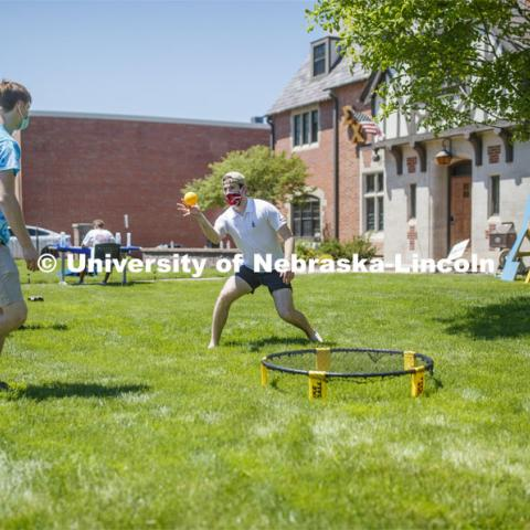 Alex Cathcart, a junior from Northridge, CA, plays spike ball with others during Sigma Chi recruitment day. Sigma Chi members are wearing masks as a result of the COVID-19 pandemic. May 29, 2020. Photo by Craig Chandler / University Communication.