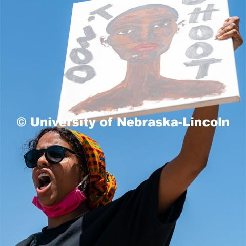 Batool Ibrahim leads protestors in chants outside of Andersen Hall on Saturday, June 13th, 2020, in Lincoln, Nebraska. Black Lives Matter Protest. Photo by Jordan Opp for University Communication.