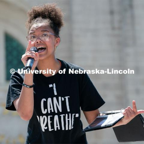 Marshawna Kapke recites a poem to the crowd of protestors outside the Nebraska State Capitol on Saturday, June 13th, 2020, in Lincoln, Nebraska. Black Lives Matter Protest. Photo by Jordan Opp for University Communication.