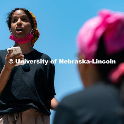 Batool Ibrahim speaks to the protestors outside of Andersen Hall on Saturday, June 13th, 2020, in Lincoln, Nebraska. Black Lives Matter Protest. Photo by Jordan Opp for University Communication.