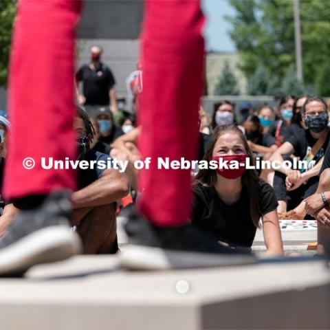 Protestors listen as Kossi Joel Kouakou delivers a speech outside of Andersen Hall on Saturday, June 13, 2020, in Lincoln, Nebraska. Black Lives Matter Protest. Photo by Jordan Opp for University Communication.