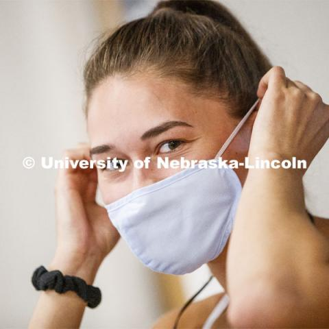 Olivia Boldt, senior from Madison, South Dakota, puts on her mask before going to work out. First day of Campus Recreation re-opening after being shut down due to COVID-19 concerns. June 15, 2020. Photo by Craig Chandler / University Communication.