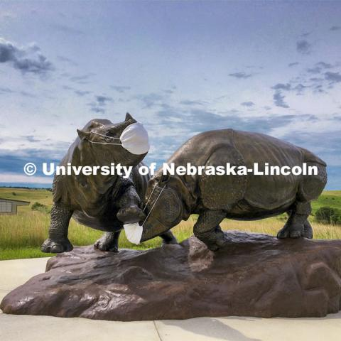 Ashfall rhinos, a sculpture by artist Gary Staab our outfitted with masks to welcome visitors to Ashfall Fossil Beds State Historical Park. Ashfall Fossil Beds State Historical Park in north central Nebraska. August 2, 2019. Photo provided.