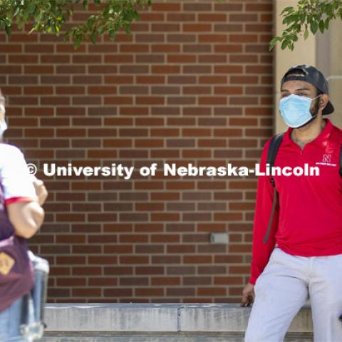 A group of students hang out wearing masks and social distancing. Photo shoot of students wearing masks and practicing social distancing. June 24, 2020. Photo by Craig Chandler / University Communication.