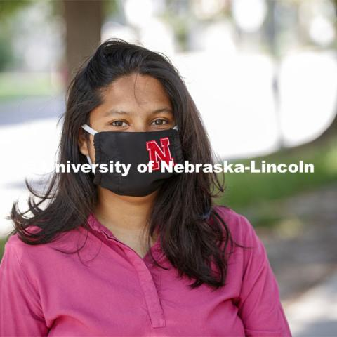 Asmita Jayswal, junior in computer science, models the new N mask. More than 60,000 face masks are to be distributed to all students, faculty and staff for the fall semester. June 26, 2020. Photo by Craig Chandler / University Communication.