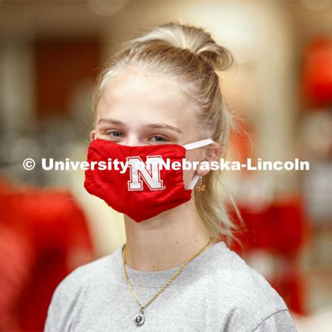 Sophia Merrill, an incoming freshman from Chanhassen, MN, models the new N mask.  Merrill was shopping in the Nebraska Union bookstore with her family. More than 60,000 face masks are to be distributed to all students, faculty and staff for the fall semester. June 26, 2020. Photo by Craig Chandler / University Communication.
