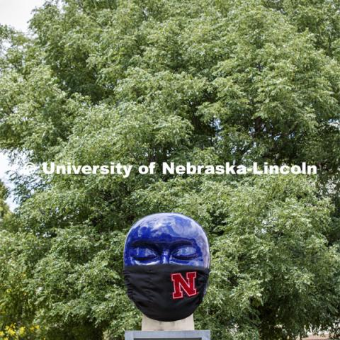 Untitled by Jun Kaneko in the Sheldon Sculpture Garden wearing a photoshopped mask. The sculpture is one of many UNL campus sculptures wearing masks. Mask wearing statues on campusJune 30, 2020. Photo by Craig Chandler / University Communication.