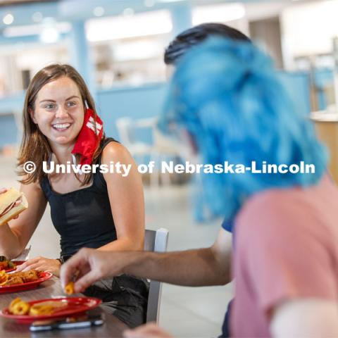 Students eating in the Willa Cather Dining Center. Photo shoot of students wearing masks and practicing social distancing in dining services in Willa Cather Dining Center. July 1, 2020. Photo by Craig Chandler / University Communication.