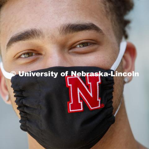 Hunter Johnson, a Junior in finance from Omaha wears a Husker mask. Photo shoot of students wearing masks and practicing social distancing in dining services in Willa Cather Dining Center. July 1, 2020. Photo by Craig Chandler / University Communication.