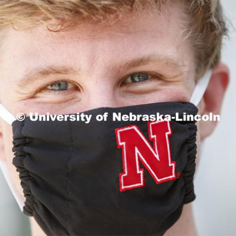 Joe Levey, senior in biology from Sturgis, SD wears a Husker mask. Photo shoot of students wearing masks and practicing social distancing in dining services in Willa Cather Dining Center. July 1, 2020. Photo by Craig Chandler / University Communication.