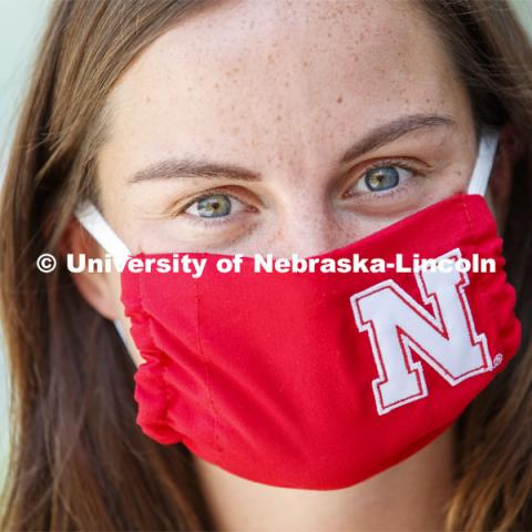 Anna Sambol, a Senior in Nutritional Science and Dietetics wears a Husker mask. Photo shoot of students wearing masks and practicing social distancing in dining services in Willa Cather Dining Center. July 1, 2020. Photo by Craig Chandler / University Communication.