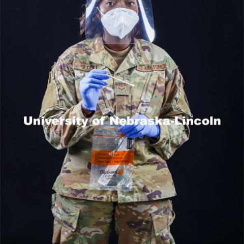 Senior Airman Tamara Silcott of the Nebraska Air National Guard wears a face shield made at Nebraska Innovation Campus. She wore the face shields along with other National Guard troops while testing thousands of Nebraskans for COVID this summer. Photo for the 2019-2020 Report Representing Nebraska's Research Heroes. July 1, 2020. Photo by Craig Chandler / University Communication.