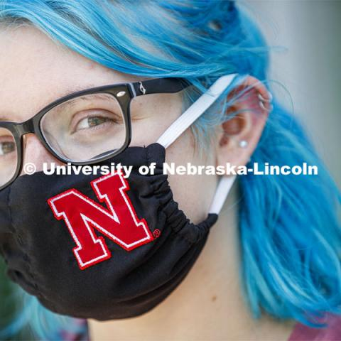 Atley Van Emmerik, a sophomore in dance from Glenvil, Nebraska wears a Husker mask. Photo shoot of students wearing masks and practicing social distancing in dining services in Willa Cather Dining Center. July 1, 2020. Photo by Craig Chandler / University Communication.