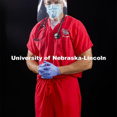 Chad Duval, an emergency physician with Nebraska Emergency Medicine, wears a face shield made at Innovation Campus. He wears the shields in his work at Bryan Hospital. Photo for the 2019-2020 Report Representing Nebraska's Research Heroes. July 2, 2020. Photo by Craig Chandler / University Communication.