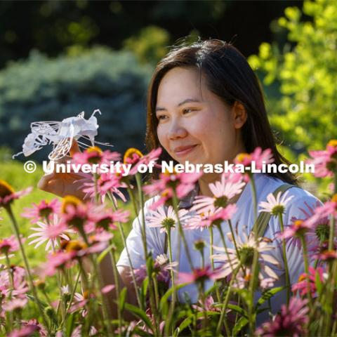 Mia Luong, a graduate student in entomology, creates intricate 3D insect art in her free time. She plans to use the art to raise funds for the Bruner Club. July 8, 2020. Photo by Craig Chandler / University Communication.