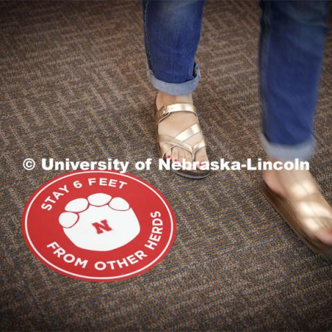 Stickers with elephant feet help patrons keep social distancing in the museum. The Nebraska State Museum in Morrill Hall will open August 5 with new procedures to keep patrons healthy and safe. July 29, 2020. Photo by Craig Chandler / University Communication.