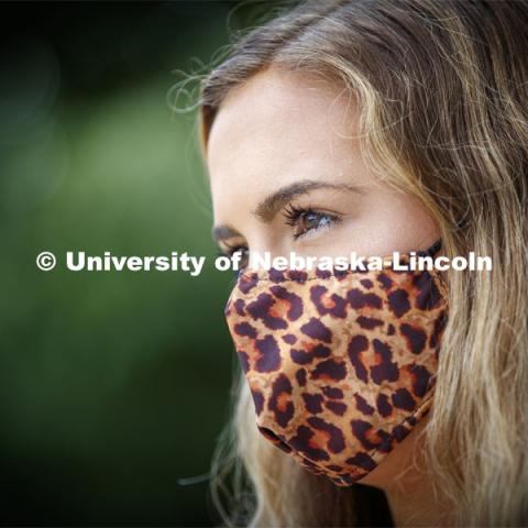 Emily Lenser, sophomore in pre-health, wears a leopard print mask.  August 6 , 2020 Photo by Craig Chandler / University Communication