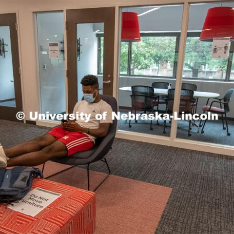 Tedum Npimnee, a junior international business major, waits for an appointment in the new Husker Hub office in Canfield Administration Building. Previously located in Pound Hall, Husker Hub recently moved into its remodeled space. August 12, 2020. Photo by Gregory Nathan / University Communication.