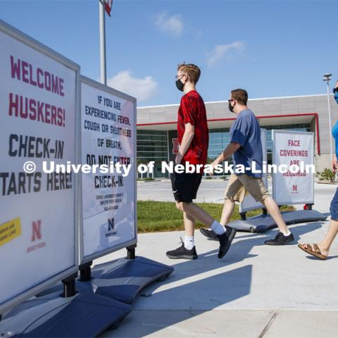 Students and family members head into Devaney Sports Center to begin their check in. First day of residence hall move in. August 13, 2020. Photo by Craig Chandler / University Communication.