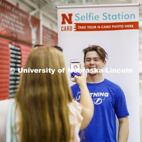 Ryan Lawton of Tampa Bay Florida has his photo taken by his mom for his N Card. Devaney Sports Center check in. First day of residence hall move in. August 13, 2020 Photo by Craig Chandler / University Communication