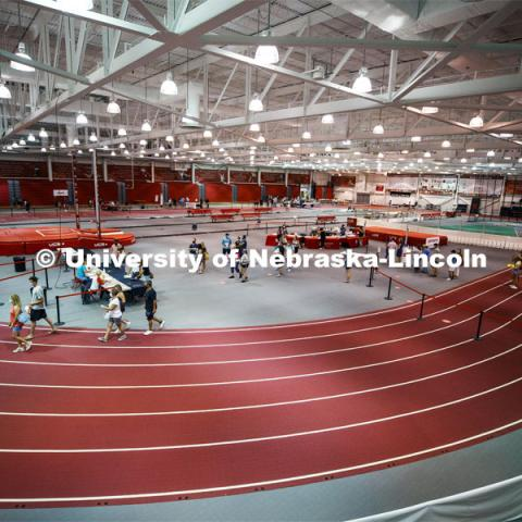 Students social distance as they work their way around the track in Devaney Sports Center to complete their paperwork and obtain their check in information. First day of residence hall move in. August 13, 2020. Photo by Craig Chandler / University Communication.