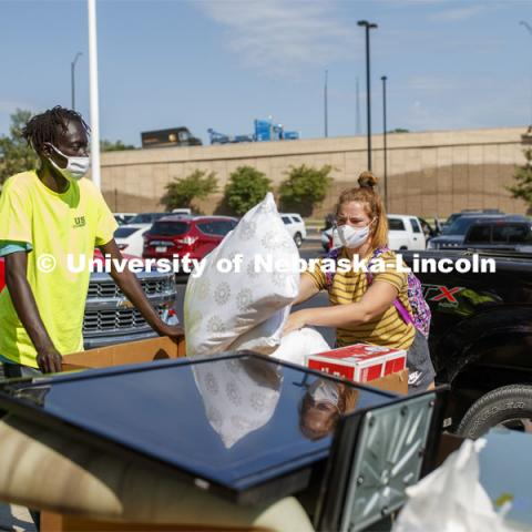 Megan Vincent of Omaha adds her last couple items to the bins loaded with her possessions outside of Harper Hall. First day of residence hall move in. August 13, 2020. Photo by Craig Chandler / University Communication.