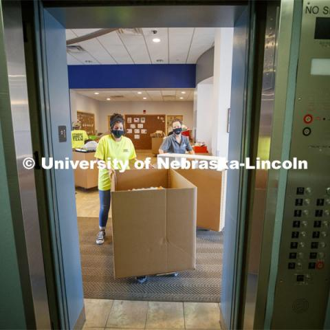 Students and family members used the stairs to avoid congestion in the lobby so the USS movers (University and Student Services) could take the student possessions to their rooms. First day of residence hall move in. August 13, 2020. Photo by Craig Chandler / University Communication.