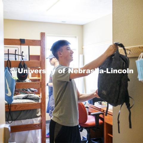 Jack Kinney of Omaha hangs up his backpack in his Knoll Residence Hall room. First day of residence hall move in. August 13, 2020. Photo by Craig Chandler / University Communication.