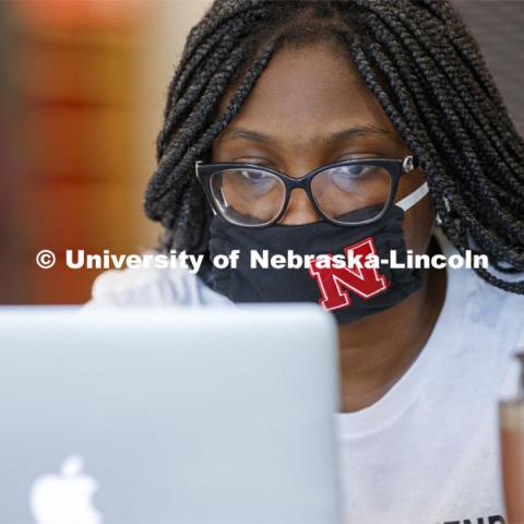 Anne Abalekpor, a senior from Omaha, studies at the Adele Coryell Hall Learning Commons. First Day of classes on UNL campus. August 17, 2020. Photo by Craig Chandler / University Communication.