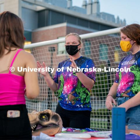 Members of the Nebraska Women's Ultimate Club speak to a student during the HuskerMania Masker Singer event at Mabel Lee Fields. August 21, 2020. Photo by Jordan Opp for University Communication.