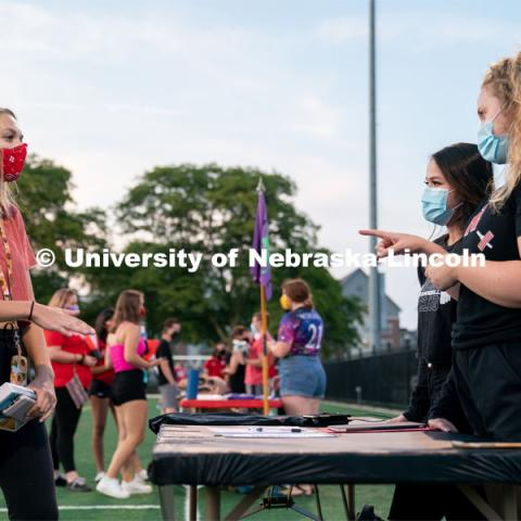 Members of the Nebraska Barbell Club (right) speak to a student during the HuskerMania Masker Singer event at Mabel Lee Fields. August 21, 2020. Photo by Jordan Opp for University Communication.