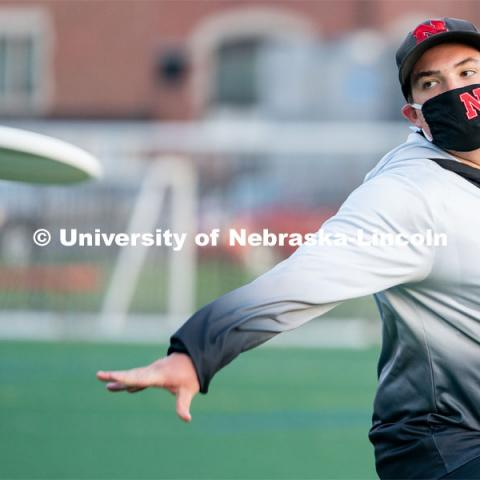 Senior Jacob Morrow throws a frisbee before the start of the HuskerMania Masker Singer event at Mabel Lee Fields. August 21, 2020. Photo by Jordan Opp for University Communication.