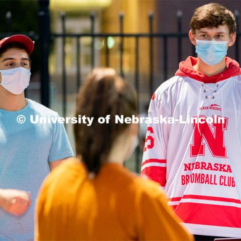Members of the Nebraska Broomball Club speak to students during the HuskerMania Masker Singer event at Mabel Lee Fields. August 21, 2020. Photo by Jordan Opp for University Communication.