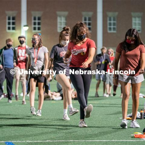 Students perform the Cupid Shuffle during the HuskerMania Masker Singer event at Mabel Lee Fields. August 21, 2020. Photo by Jordan Opp for University Communication.