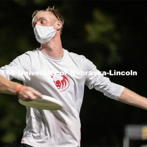 Senior Josh Adams throws a frisbee during the HuskerMania Masker Singer event at Mabel Lee Fields. August 21, 2020. Photo by Jordan Opp for University Communication.