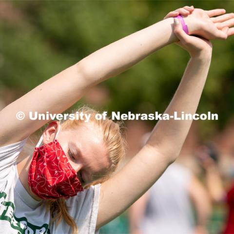 A student performs a yoga pose during Wellness Fest at Meier Commons. August 22, 2020. Photo by Jordan Opp for University Communication.