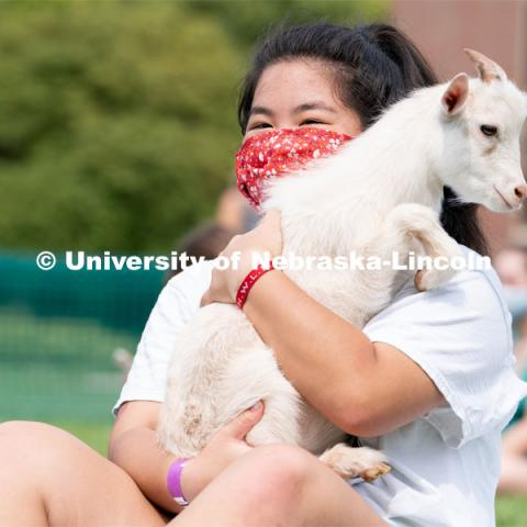 Sophomore Zoey Doan holds a goat during Wellness Fest at Meier Commons. August 22, 2020. Photo by Jordan Opp for University Communication.