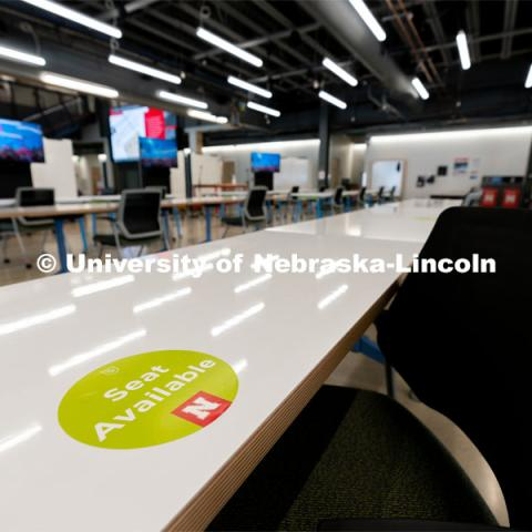 "A table with a ""seat available"" sticker is photographed inside the Johnny Carson Center for Emerging Media Arts during the first day of in-person instruction at the University of Nebraska-Lincoln on Monday, August 24, 2020. Photo by Jordan Opp for University Communication."