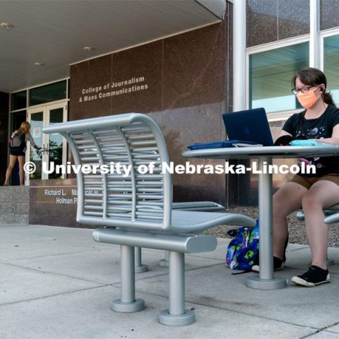 Freshman Journalism major Samantha Grove listens to a lecture through Zoom outside of Andersen Hall during the first day of in-person instruction at the University of Nebraska-Lincoln on Monday, August 24, 2020. Photo by Jordan Opp for University Communication.