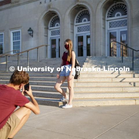 Alyssa Johnson has her photo taken by Tanner Huber in front of the Nebraska Union as the two walk to class. First day for in-person learning for the fall semester. August 24, 2020. Photo by Craig Chandler / University Communication.